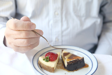 Man with two kinds of cheesecake
