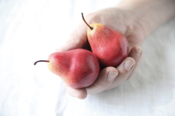 Man holds red Forelle pears