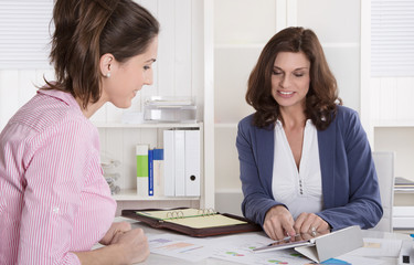 Professional business meeting under two woman: client and advise