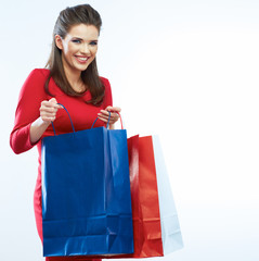Shopping woman portrait isolated. White background. Happy shopp