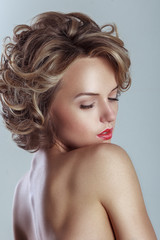 Beautiful blond woman with curly hairstyle