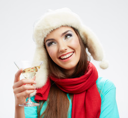Woman winter style clothes portrait. Smiling model with alcohol