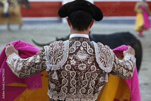 Leinwandbild Motiv Bullfighter and bull