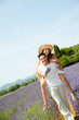 romantic young couple man woman summer holiday fun countryside