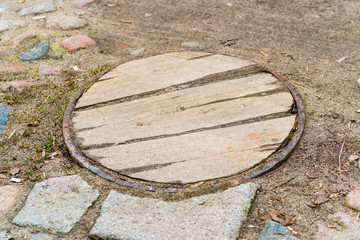 Manhole cover composition as a background