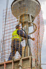 Builder worker using concrete funnel