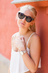 Blonde teenage girl with sunglasses