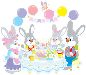 Birthday, family of rabbits at the holiday table