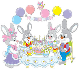 Family of rabbits at the holiday table