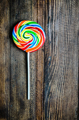 Lollipop on wooden background