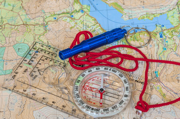 Compass on Map and Rescue Whistle