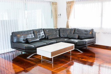 Black sofa in room