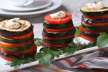 appetizer of zucchini, tomatoes and aubergines baked with dill