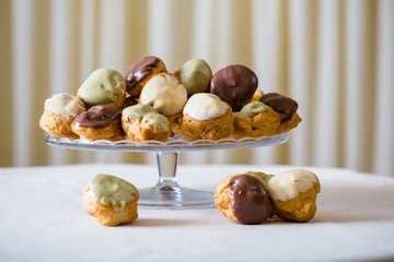 Profiterole, cream puff - French dessert choux pastry ball fille