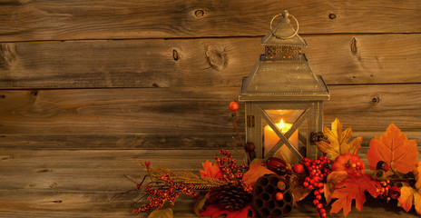 Traditional Asian Lantern with autumn Decorations on Rustic Wood