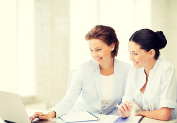businesswomen working with laptop in office