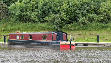 A Traditional Narrow Boat Moored in a Canal Basin.