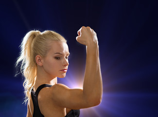 close up of athletic woman flexing her biceps