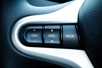Audio Control Buttons on Steering Wheel of Modern Car