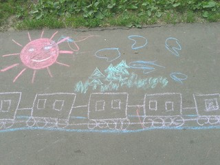Children drawing with chalk