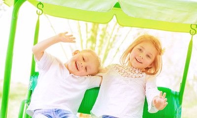 Happy kids on the swing