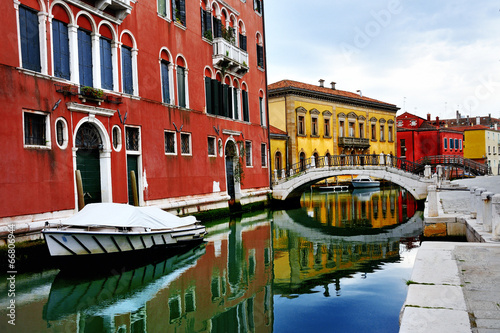 Fototapeta Venice, Burano island, boats on canal and colorful houses, Italy