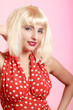 Portrait pinup girl in blond wig retro red dress. Vintage.