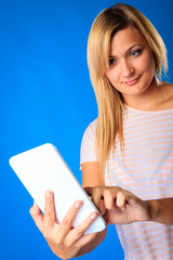 Woman girl using tablet touchpad reading e-book e-reader on blue