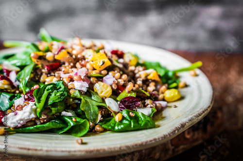 Tuinposter Voorgerecht Healthy salad with spinach,quinoa and roasted vegetables