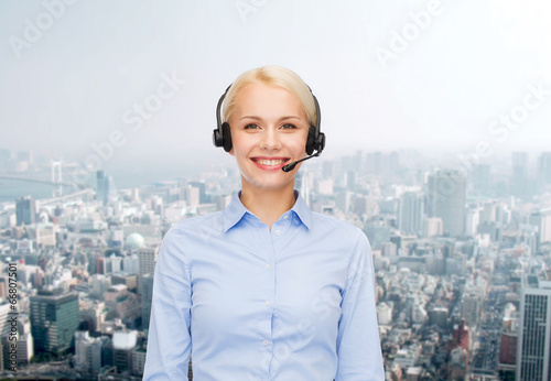 canvas print picture friendly female helpline operator with headphones