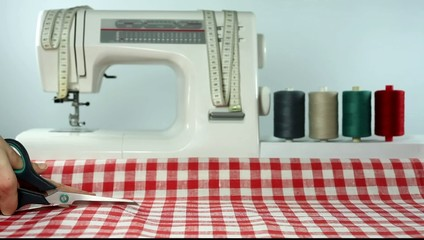 Tailor. Cutting fabric. Dressmaker at work. Sewing.