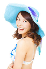 young woman holding a sun hat . isolated on a white background