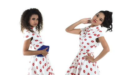 Two pin up models posing on white background