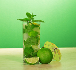 Mojito glass, an umbrella, mint and juicy lime