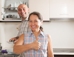 woman and man  in home kitchen