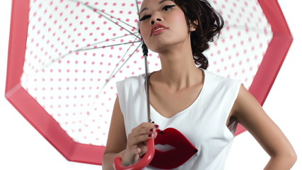 Asian woman with an umbrella posing in studio