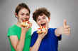 Girl and boy eating cake with cream and fruits , OK sign