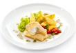 Fish dish - fried fish fillets and vegetables
