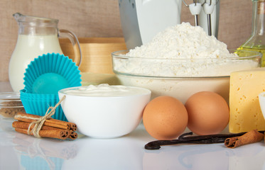 Eggs, sour cream, spices, flour, cheese, cake pan