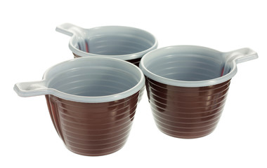 Three disposable plastic brown coffee cups