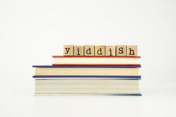 yiddish language word on wood stamps and books