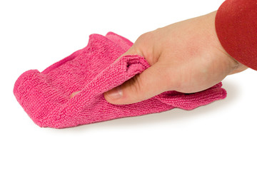 Hand holding a magenta sponge and wipe dust