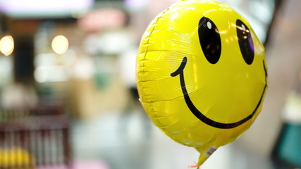 Smiling balloon floating in the air