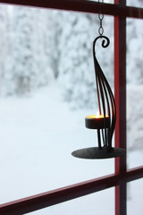 Decorative candle holder on window