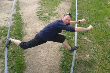 Man showing strenght on slackline
