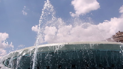 Water falling from a fountain against blue sky