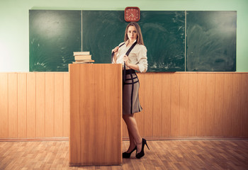 sexy teacher at classroom interior