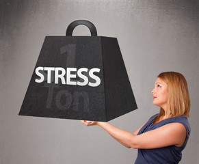 Young woman holding one ton of stress weight