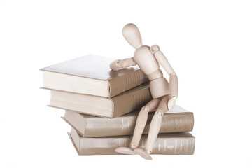 wooden dummy sits on books