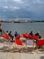 Tourists relaxing in Hafen City in Hamburg